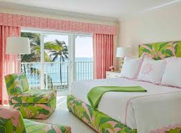 green and pink bed with pink scalloped