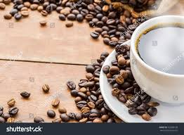 With black coffee, the beans are roasted for variable amounts of time, depending on the desired brew strength, and mixed with margarine and sugar. Top View White Coffee Cup And Coffee Beans On Wood Floor Background Ad Ad White Coffee Top View White Coffee Cups Coffee Stock Coffee Cups