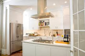 stove exhaust hood. example of a classic l-shaped kitchen design in new york with stainless steel appliances stove exhaust hood