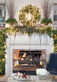 interior white fireplace mantel with black metal fire cover and green garland also wreath with