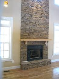 electric fireplace with stone surround fabulous floor to ceiling stacked stone fireplace design ideas with natural
