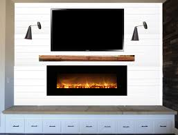 shiplap fireplace with modern insert suburban es