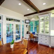 office in kitchen. white kitchen with home office and breakfast table in