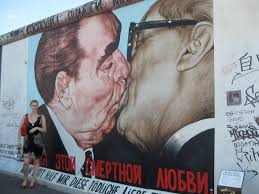 the famous brezhnev honecker brotherly kiss  on famous berlin wall artists with plus1press berlin wall art