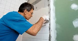laying ceramic tiles must be carried out only on the moisture resistant drywall