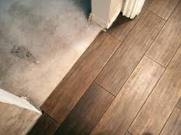 wood look porcelain tile vs vinyl plank flooring ceramic reviews trendy planks installation bathroom