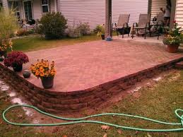 slope for patio with retaining wall
