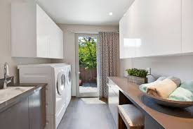 Modern Laundry Room with Undermount Sink, Ash Gray Quartz, Built-in  bookshelf,