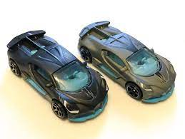 The 2018 bugatti divo will be issued in the following 1/64 scale versions: First Look Of The 2021 Matchbox Bugatti Divo Mix 1 2021 In Matte Black Vs 2020 First Release Pic Source From Lamle Group On Instagram Hotwheels