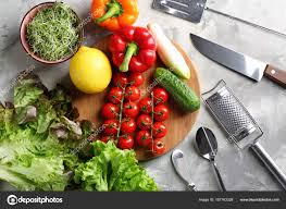 Wooden Board With Vegetables And Utensils On Kitchen Table Cooking