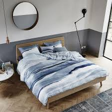 evoke scenes of nature with this mooa duvet cover from essenza made from cotton satin with a 220 thread count this duvet cover instantly transforms a