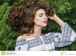 <b>Woman</b> With Long <b>Curly</b> Hair Lying On <b>Spring</b> Grass Stock Image ...