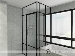 this bathroom manages to fit a bathtub and a shower area made of glass with dark frames a style that is gaining popularity in modern bathroom designs