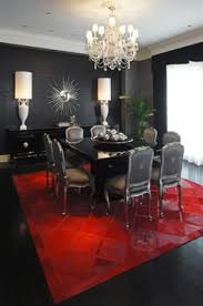 make your room more standout with these gorgeous rugs enchanting red bold rug in elegant dining room design with fancy white chandelier and black gl