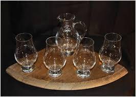 glencairn whisky glass and jug holder four glasses and jug on a quarter barrel lid