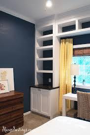 built ins around window regarding diy built in bookshelves part three they re done