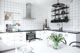 industrial black metal kitchen shelving unit made of lightweight metal white ceramic tiles walls gloss metal