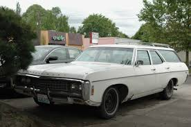 OLD PARKED CARS.: 1969 Chevrolet Kingswood.