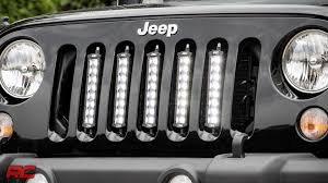 installing 2007 2017 jeep wrangler jk vertical 8 inch led light bar grille mount by rough country you