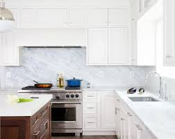 white kitchen cabinets with damascus blue marble countertops and backsplash
