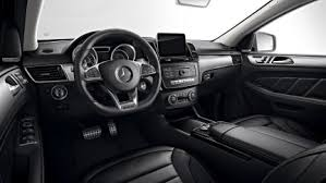 mercedes benz amg interior. amg emblems in the head restraints lend interior a special luxurious note set against black appointments gray seat belts and mercedes benz amg