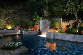 tropical outdoor lighting. bronze outdoor waterfall fountains pool tropical with lounge chairs lighting o