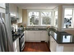 black cabinets white countertops black kitchen cabinets white black kitchen cabinets with white marble countertops