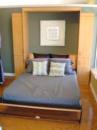 furniture astounding design hideaway beds. murphy bed with blue mattress and colorful pillows for smaller bedroom space furniture astounding design hideaway beds y