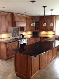 kitchen cabinets rochester ny unique black granite countertops in a classic wooden kitchen with kitchen