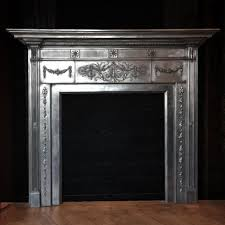 pair of antique polished cast iron neoclassical adams style fire surrounds at thearchitecturalforum com