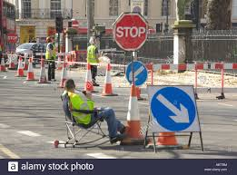 london sitting down on the job concept ideas image workman seated london sitting down on the job concept ideas image workman seated controlling traffic around road works