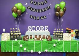 boy s football birthday party dessert bar with favors and stadium cupcake stands
