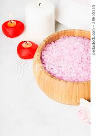 bath salt with aroma of a rose in a wooden bowl