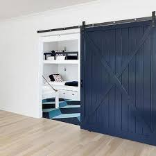 kids room with navy barn door