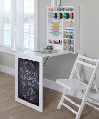 Recollections Fold Down Craft Table ~ I think I could make one similar.  Could also be a fold down desk in a small bedroom or other area.