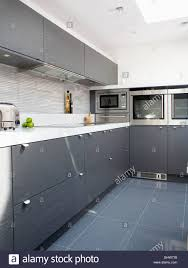 Grey Ceramic Floor Tiles In Modern White Kitchen With Dark Gray