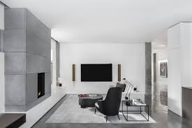 contemporary living room with stylish gray fireplace matching the rug