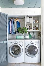 Small industrial porcelain floor laundry closet idea in Chicago with wood  countertops, gray walls,