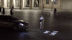 Designed by stuttgart engineers, the system issues safety warnings by projecting graphics onto the. Mercedes Benz Digital Light Technology Car Communicates With You Through Words Drivespark News