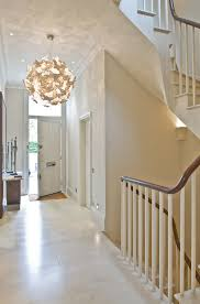 beachy lighting fixtures entry contemporary with wood banister white wall white front door