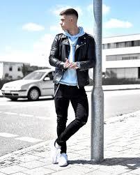black leather jacket hoo sweatshirt dark jeans and white sneaker