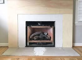 with the fireplace surround clad in plywood and the brick covered in thin set