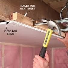 how to hang sheet rock holding up sheet rock for finishing a ceiling diy home projects