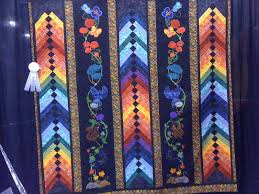 Road to California Quilt Show Booth #822 | QBOT & During the quilting retreat last weekend Jane was finishing up her braided  quilt. This quilt is the same quilt with appliqued flowers and insect  through the ... Adamdwight.com
