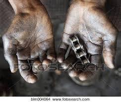 asian man holding machine part