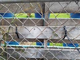 wire fence covering. Heavy Duty Zip Ties Hold Pallet To Chain Link Fence Wire Covering