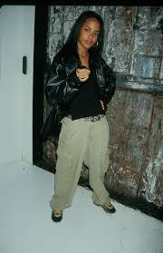 The bucket hats—you'd have to be crazy to want to time travel your closet back to the '90s, right?! 10 Times Aaliyah S Cyber Futuristic Tomboy Style Defined The 90s British Vogue