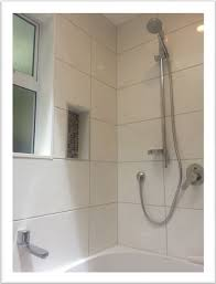 shower over bath with sliding shower rail tiled walls and tiled wall cavity