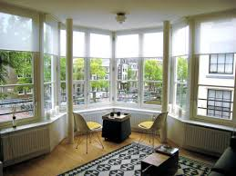 bay window furniture bench along the bay windows area a pair of chairs simple table with bay window furniture