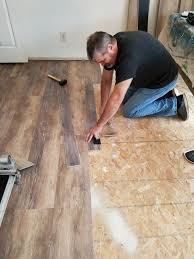 diy installing vinyl floors when you are tapping it into place